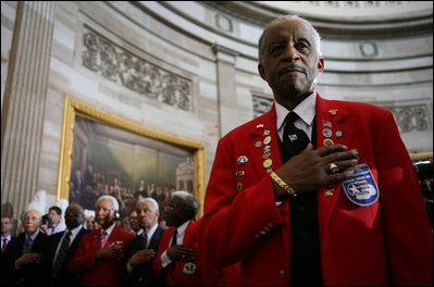 A member of the Tuskegee Airmen stands with his hand over his heart during the National Anthem Thursday, March 29, 2007, at the U.S. Capitol where he and his fellow airmen were bestowed the Congressional Gold Medal, the highest civilian award bestowed by the United States Congress. White House photo by Eric Draper