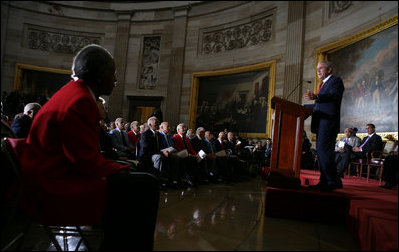 """President George W. Bush speaks during the Congressional Gold Medal ceremony for the Tuskegee Airmen Thursday, March 29, 2007, at the U.S. Capitol. Said the President, """"The Tuskegee Airmen helped win a war, and you helped change our nation for the better. Yours is the story of the human spirit, and it ends like all great stories do – with wisdom and lessons and hope for tomorrow."""" White House photo by Eric Draper"""