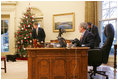 President George W. Bush calls Barney to the Oval Office, Friday, Dec. 1, 2006, to tape their segment for this year's Barney Cam video.