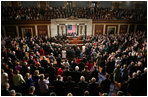 The House comes to its feet as President George W. Bush arrives at the podium Tuesday, Jan. 31, 2006, to give his State of the Union address.