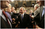 President George W. Bush is congratulated by Tennessee Rep. Harold Ford and Louisiana Sen. Mary Landrieu as he leaves the U.S. House Chamber Tuesday, Jan. 31, 2006, following his State of the Union address.