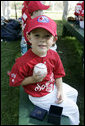 Nathan Chando of Hudsonville, Mich. holds up a baseball he received from President George W. Bush following the Tee Ball on the South Lawn: A Salute to the Troops game Sunday, Sept. 7, 2008, on the South Lawn at the White House. White House photo by Grant Miller