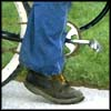 Photo of foot peddling a bicycle