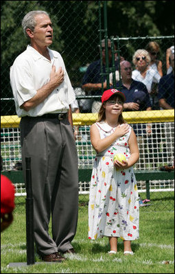 President George W. Bush is joined for the singing of the national anthem by Meredith Cripe, a member of the Chantilly, Virginia Little League Challenger League, at the top of the first White House Tee Ball Game of the 2007 season. The game pitted the Bobcats from Cumberland, Maryland, against the Red Wings of Luray, Virginia.