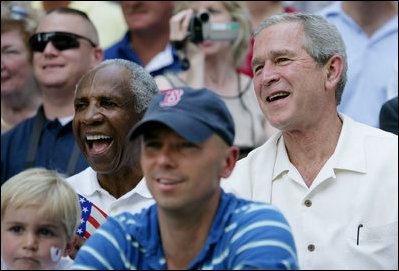 President George W. Bush and baseball Hall of Famer Frank Robinson, left, cheer on players participating in the Tee Ball on the South Lawn All-Star Game Wednesday, July 16, 2008, where the teams Eastern U.S. vs.Central U.S., and Southern U.S. vs. Western U.S., played in an afternoon doubleheader at the White House.