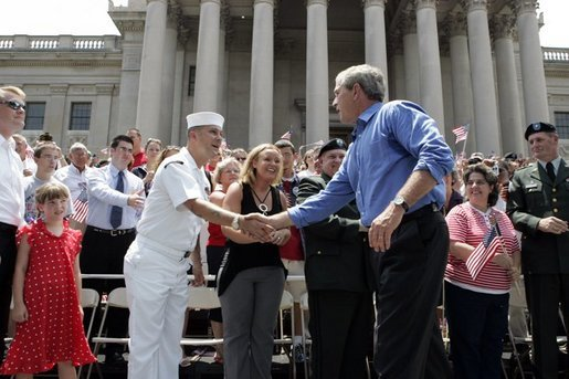President George W. Bush greets the crowd at the Fourth of July Celebration on the steps of the Capitol in Charleston, West Virginia on Independence day, 2004. White House photo by Tina Hager