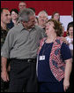 President George W. Bush embraces Joy Enders, president of the 167th Airlift Wing Family Readiness Group, Wednesday, July 4, 2007, during a Fourth of July visit with members of the West Virginia Air National Guard 167th Airlift Wing and their family members in Martinsburg, W. Va. President Bush thanked Enders and members of her organization for their mission to care for the families of deployed Guard members. White House photo by Chris Greenberg