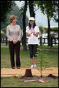 Mrs. Laura Bush stands with Natsumi Kagawa, age 11, after planting a tree at the Toyako New Mount Showa Memorial Park Wednesday, July 8, 2008, during a tree planting ceremony in Hokkaido, Japan. White House photo by Shealah Craighead