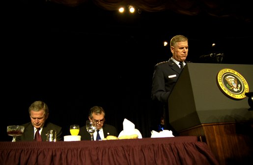 """Led in prayer by the Chairman of the Joint Chiefs of Staff General Richard Myers, President George W. Bush and Congressman Ray LaHood (R-IL) pray during the National Prayer Breakfast in Washington, D.C., Thursday, Feb. 6, 2003. """"In this hour of our country's history, we stand in the need of prayer. We pray for the families that have known recent loss. We pray for the men and women who serve around the world to defend our freedom,"""" said the President in his remarks. """"We pray for their families. We pray for wisdom to know and do what is right. And we pray for God's peace in the affairs of men."""" White House photo by Eric Draper."""