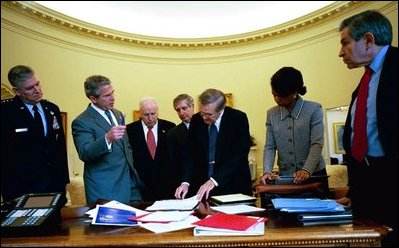 President George W. Bush and senior advisors look at a map of Iraq on the Resolute Desk in the Oval Office April 2, 2003. Pictured, from left, are Gen. Richard Myers, Vice President Dick Cheney, Chief of Staff Andy Card, Defense Secretary Donald Rumsfeld, National Security Advisor Dr. Condoleezza Rice and Defense Under Secretary Paul Wolfowitz.