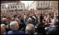 President George W. Bush reaches out to the crowd Saturday during his visit to St. Mark's Square in Zagreb. More than 3,000 people were on hand to welcome the President during his visit. White House photo by Eric Draper