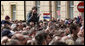 A young girl, atop the shoulders of a friend to get a better view, applauds in the crowd at Zagreb's St. Mark's Square as President George W. Bush addresses the thousands who turned out to welcome him Saturday April 5, 2008. White House photo by Shealah Craighead