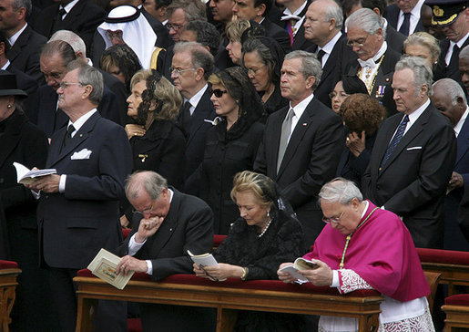 President George W. Bush and Laura Bush stand amidst mourners at funeral services Friday, April 8, 2005, for the late Pope John Paul II in St. Peter's Square. The funeral is being called the largest of its kind in modern history.White House photo by Eric Draper