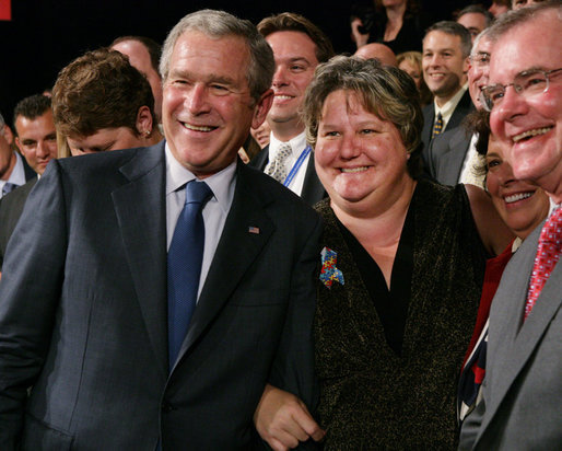 President George W. Bush stands with Karen Woodings of the Central Pennsylvania Food Bank following his address to the Lancaster Chamber of Commerce and Industry at the Jay Group Inc., Wednesday, Oct. 3, 2007 in Lancaster, Pa. President Bush joked with Woodings during the question and answer segment of his visit when she became nervous asking him a question. White House photo by Chris Greenberg