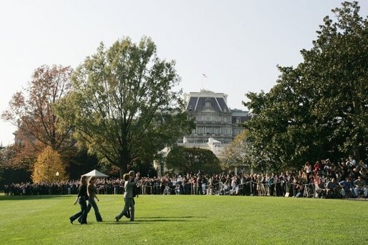 President George W. Bush and Laura Bush arrive from Texas with their daughters Barbara, left, and Jenna, right, as staff applaud on the South Lawn of the White House, Nov. 2, 2004. White House photo by Paul Morse