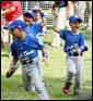 Players of the Jose M. Rodriguez Little League Angels of Manati, Puerto Rico, jubilate at the conclusion of the 2008 Tee Ball game on the South Lawn Season Opener Monday, June 30, 2008, on the South Lawn of the White House. White House photo by Joyce N. Boghosian