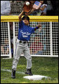 The first baseman of the Jose M. Rodriguez Little League Angels from Manati, Puerto Rico reaches up to catch the ball during the season opener of the 2008 Tee Ball on the South Lawn Monday, June 30, 2008, on the South Lawn of the White House. White House photo by Eric Draper