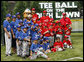 Teams participating in the opening game of the 2008 Tee Ball on the South Lawn, the Cramer Hill Little League Red Sox of Camden, N.J., and the Jose M. Rodriguez Little League Angels of Manati, Puerto Rico, pose together Monday, June 30, 2008, for a photo on the South Lawn of the White House. White House photo by Eric Draper