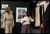 """Laura Bush looks at costumes designed by members of the Will Power to Youth program before watching a performance of """"Romeo and Juliet"""" at the Shakespeare Festival/LA's theater in Los Angeles April 26, 2005. Students in the program write their own versions of Shakespeare's plays, create the music, costumes and construct the sets for each production."""