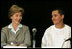Laura Bush talks with Freddy Martinez, 17, during a roundtable discussion on stopping violent crime in Chicago on June 2, 2005. CeaseFire Chicago is a public health initiative that works with community partners to reduce violence.