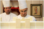 Thaddeus DuBois, Head Pastry Chef, inspects the roof on top of the official White House gingerbread house.