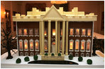 The White House gingerbread house, created by White House Executive Pastry Chef Thaddeus DuBois, is seen on display in the State Dining Room.