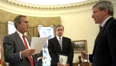 President George W. Bush meets with Dan Bartlett, center, and Josh Bolten in the Oval Office Jan. 9, 2003.  White House photo by Eric Draper.