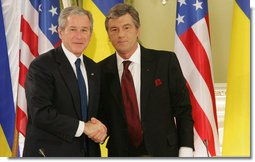 President George W. Bush and President Viktor Yushchenko of the Ukraine shake hands after their joint press availability Tuesday, April 1, 2008, at the Presidential Secretariat in Kyiv. President and Mrs. Laura Bush attended daylong events in the Ukraine capital before departing for Romania, site of the 2008 NATO Summit. White House photo by Chris Greenberg