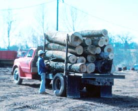 Worker releases load binders from the side opposite the unloading side.