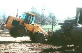 Unsafe operation of loader in log yard