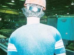 Wood dust shown on worker.