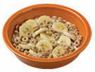 Bowl of cereal with bananas