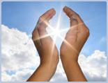 Cupped Hands Held Up in Front of the Sun