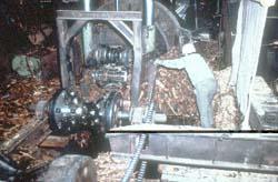 Employee cleaning debarker area