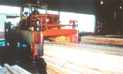 Straddle carrier truck used for moving lumber
