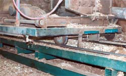 Log carriage with one rail sweep missing