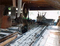 Log carriage on head rig without carriage travel stop barrier. #1