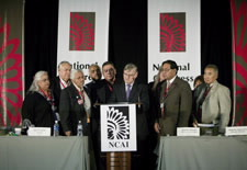 Joe Garcia, President of National Congress of American Indians (third from left), and its Executive Board witness Census Bureau Director Steve Murdock as he signs the Census Bureau's first American Indian and Alaska Native Policy. Click here for larger image.