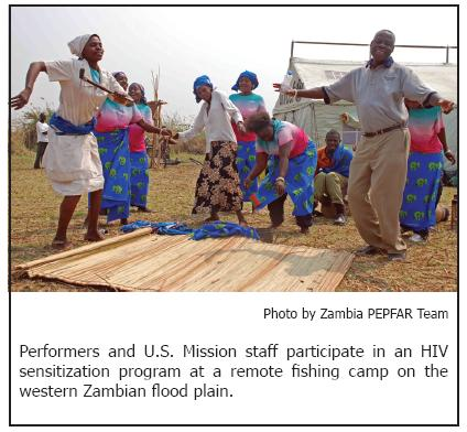 Performers and U.S. Mission staff participate in an HIV sensitization program at a remote fishing camp on the western Zambian flood plain.