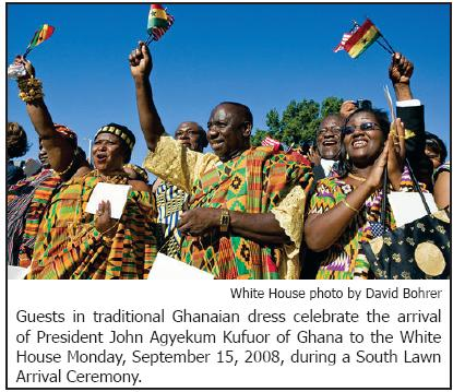 Guests in traditional Ghanaian dress celebrate the arrival of President John Agyekum Kufuor of Ghana to the White House Monday, September 15, 2008, during a South Lawn Arrival Ceremony.