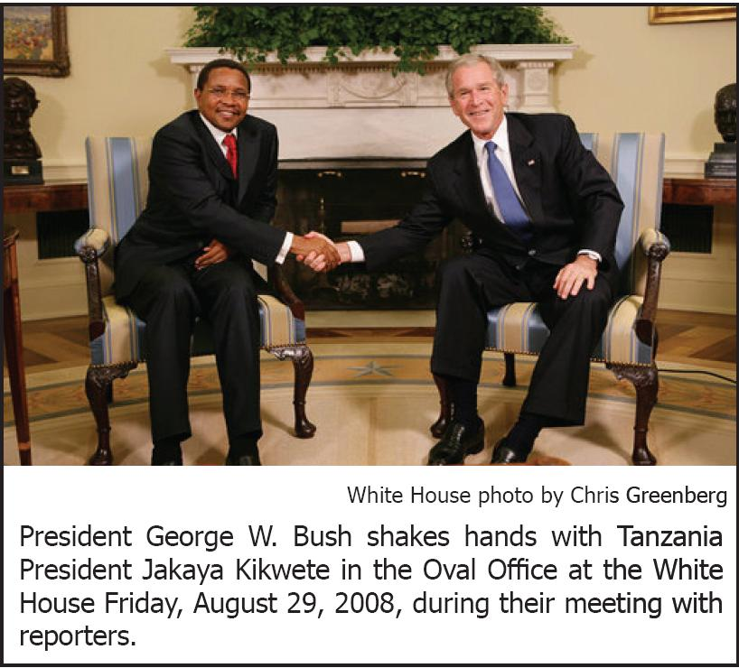 President George W. Bush shakes hands with Tanzania President Jakaya Kikwete in the Oval Office at the White House Friday, August 29, 2008, during their meeting with reporters.