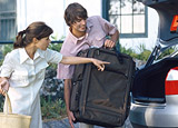 Man and woman loading their car with luggage