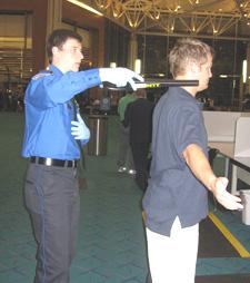 photo of TSA screening a passenger