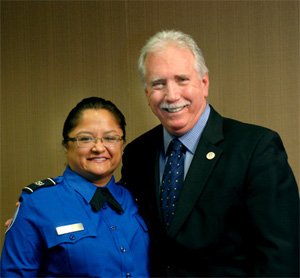 Photo of Corinne Gamino, lead TSO, Fresno (Calif.) Yosemite International Airport, taking time during her headquarters visit to pose with Mo McGowan, former assistant administrator for Security Operations.