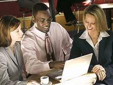 Business people sitting with a laptop
