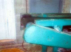 Guarded drive mechanism on belt conveyor.