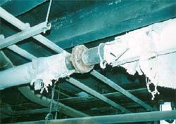 Damaged asbestos pipe lagging in sawmill basement.