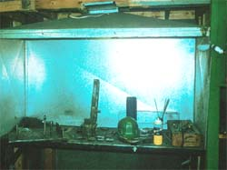 Inadequate exhaust hood for babbit operation in file room.