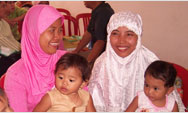 Women in Wonokromo, Indonesia, meet on a regular basis to discuss and share health and childcare information that helps to ensure healthy mothers and babies  - Click to read this story