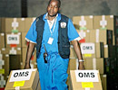 WHO warehouse worker carries medical supplies, DR  Congo